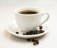 Free Cup Of Coffee And Beans Royalty Free Stock Image - 22977266