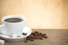 Cup Of Coffee And Beans On Wood Stock Photography