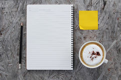 Cup Of Coffee And Notebook Royalty Free Stock Photo