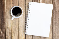 Cup Of Coffee And Notebook On Office Wood Table. Royalty Free Stock Images