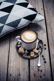 Cup Of Coffee And Pillow On Wooden Floor Royalty Free Stock Photos