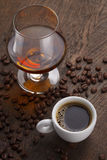 Cup Of Coffee, Cognac Glass And Coffee Beans Royalty Free Stock Photo