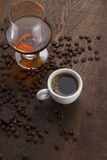 Cup Of Coffee, Cognac Glass And Coffee Beans Royalty Free Stock Photography