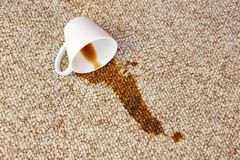 Free Cup Of Coffee Fell On Carpet. Stain Is On Floor Royalty Free Stock Photos - 147446048