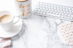 Cup Of Coffee, Notepad And Keyboard On White Marble Table Royalty Free Stock Images