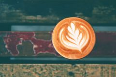 Free Cup Of Hot Cappucino Is On The Wooden Painted Table Stock Image - 113191961