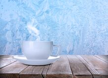 Free Cup Of Hot Tea On Table Near Window Covered With Frost Royalty Free Stock Image - 216500956