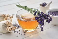 Free Cup Of Lavender Tea And Lavender Flowers. Mortars Of Dry Lavender And Sachets On Background. Alternative Medicine Royalty Free Stock Images - 189162229