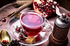 Free Cup Of Pomegranate Tea Stock Photo - 107606330
