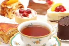 Cup Of Tea And Various Cakes Stock Photos