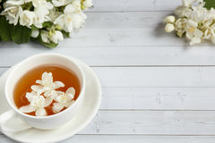 Free Cup Of Tea, Pouring Honey From A Spoon In A Jar, Jasmine Flowers On A Light Wooden Background. Copy Space Royalty Free Stock Photography - 96482897