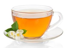Cup Of Tea With A Saucer And The Jasmine Flower Royalty Free Stock Photos