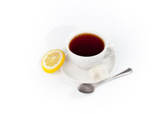 Cup Of Tea With Lemon And Spoon Isolated On White Stock Image