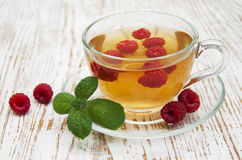 Cup Of Tea With Raspberry Stock Photo
