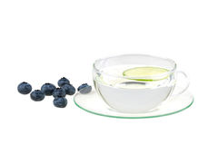 Cup Of Water With Lemon And Huckleberries Royalty Free Stock Images