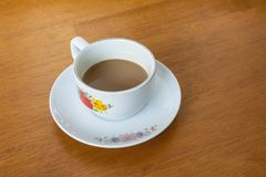 Cup off coffee on wood Royalty Free Stock Image