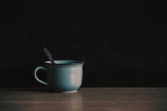 Cup on the old wooden and dust. Royalty Free Stock Photo
