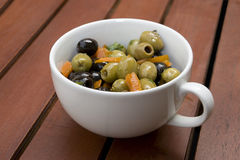 Cup of Olives. And sliced peppers Royalty Free Stock Photography