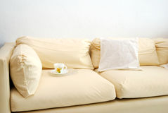 Cup On Sofa Stock Image