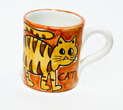 Cup with orange cat Stock Image
