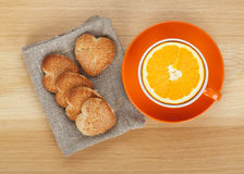 Cup with orange and cookies Royalty Free Stock Photo