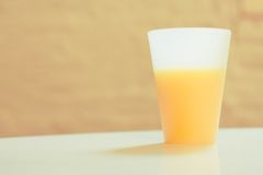 A Cup of Orange Juice. Orange juice in a frosty white cup Stock Images