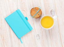 Cup of orange juice, gingerbread cookies and notepad Royalty Free Stock Images