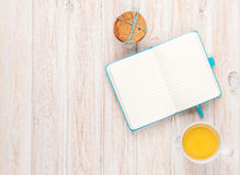 Cup of orange juice, gingerbread cookies and notepad Royalty Free Stock Photography