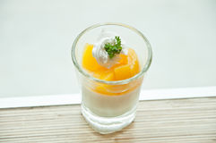 Cup of orange panna cotta on the table Royalty Free Stock Photos