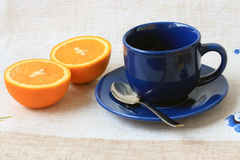 Cup and the orange Stock Photo
