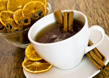 Cup of orange tea with cinnamon Royalty Free Stock Photos
