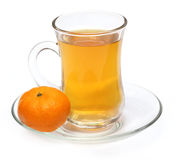 Cup of orange tea with orange Stock Photo