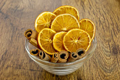 Cup of oranges with cinnamon Royalty Free Stock Image