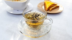 A cup of organic tea for breakfast or relaxing time. Some special essence about health Royalty Free Stock Photo