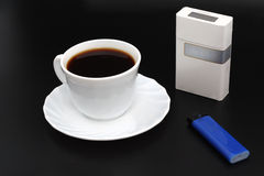 Cup os coffee. Cigarettes and lighter. Royalty Free Stock Image