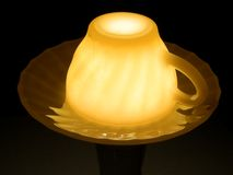 Cup over a candle. A ceramic cup turned over a light or a candle Stock Images