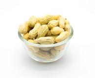 Cup of peanuts on white background Stock Photos