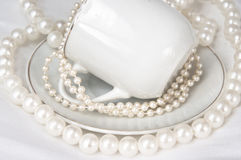 Cup and Pearls Royalty Free Stock Image