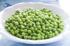 Cup of peas Royalty Free Stock Photos