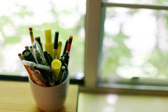 Cup of pens and pencils. Indoor close-up of cup of pens and pencils Stock Image