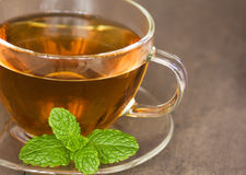 A cup of peppermint tea Royalty Free Stock Image