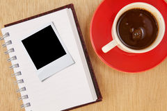Cup and photo frame Royalty Free Stock Image