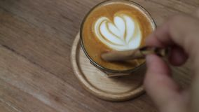 A Cup of Piccolo latte coffee with latte art stock video