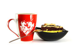 A cup with a picture of the heart, with a sweet dessert. Royalty Free Stock Photo