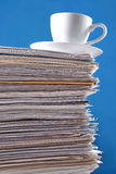 Cup on a pile of papers Stock Photography