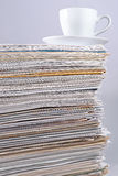 Cup on a pile of papers Royalty Free Stock Image