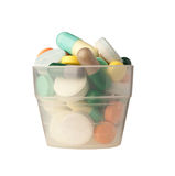 Cup of pills Royalty Free Stock Images