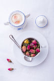 Cup of pink roses tea Stock Image
