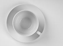 Cup on a plate Stock Photography