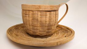 Cup & plate of cane stock images